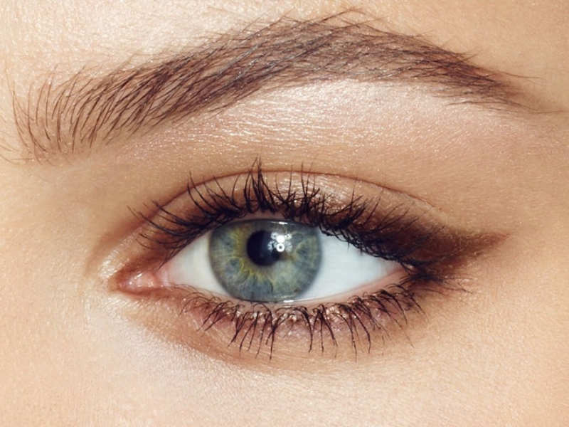 Use a brown kohl pencil as a guide for liquid eyeliner