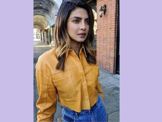 592046eece8 Priyanka Chopra looks chic in a grey check blazer with a matching ...